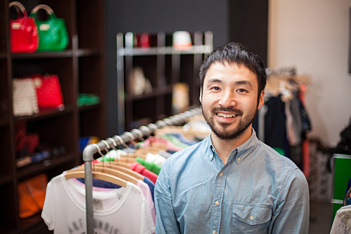 A male clerk standing in a boutique